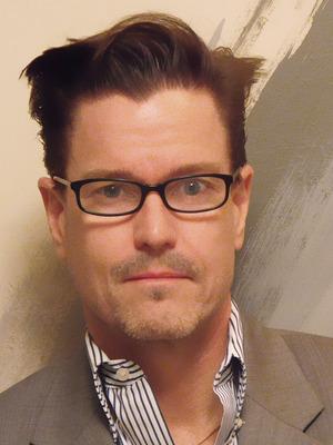 E. Scott Denison
